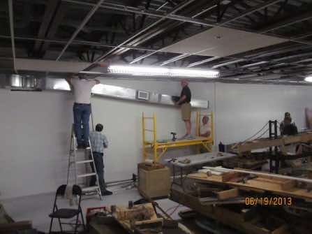 A HVAC duct had to be relocated from the center to the side of the main room.